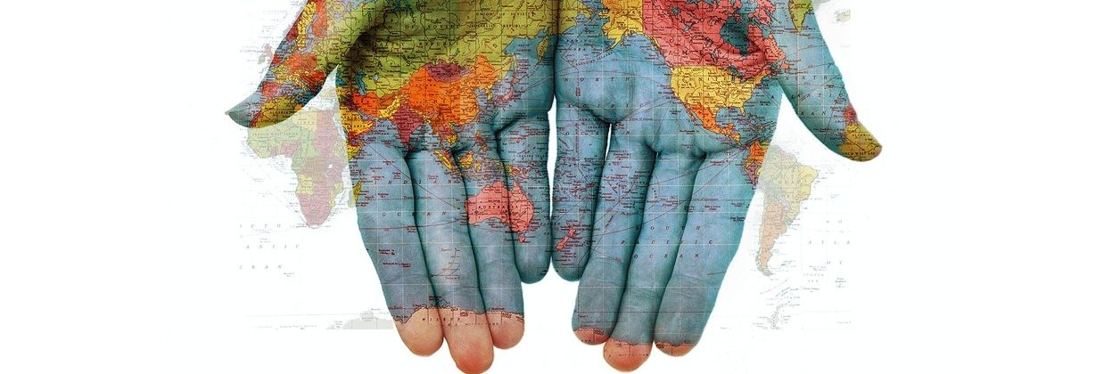 cropped-world_map_hands.jpg